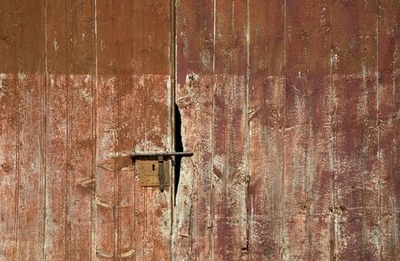An aged door detail: latch and keyhole Stock Photo - 740771