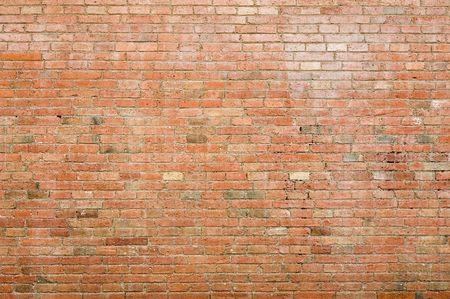 paredes de ladrillos: Una vieja pared resistida del ladrillo; ladrillo expuesto Foto de archivo