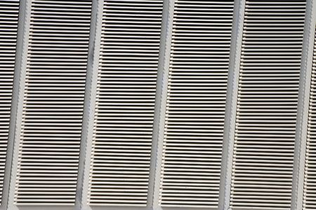 louvered: A close-up of a metal louvered wall