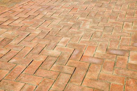 empedrado: Primer plano de un ladrillo de edad patio pavimentado