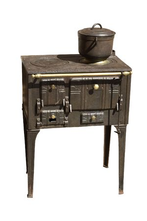 An ancient cast iron range cooker, isolated