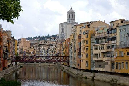 Cathedral and typical colorful houses in Girona, Catalonia, Spain