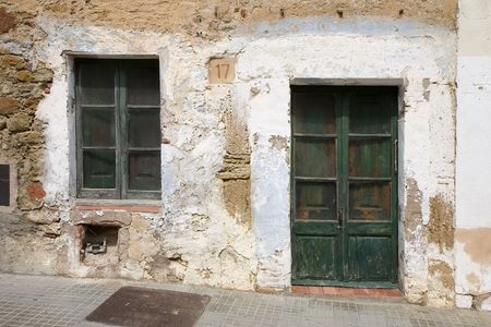 stucco house: An old weathered house in Catalonia, Spain
