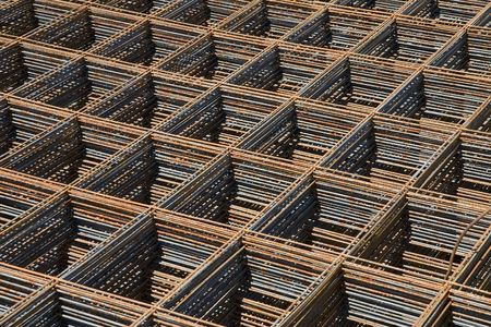 Stack of reinforcing bar mesh in a construction site Stock Photo