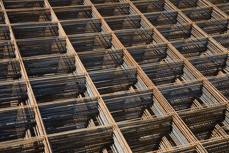 Stack of reinforcing bar mesh in a construction site photo