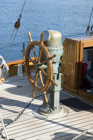 wheelhouse: A wooden steering wheel on a sailboat