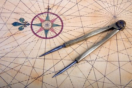 Ancient brass dividers on a nautical chart Stock Photo