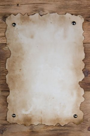Old paper tacked to a wood wall Stock Photo - 2651510