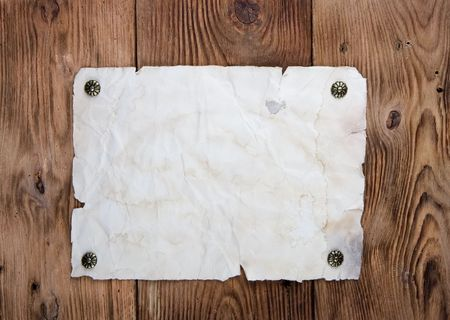 Old paper tacked to a wood wall Stock Photo - 2651512