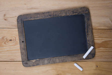 An old blank blackboard and white chalk Stock Photo