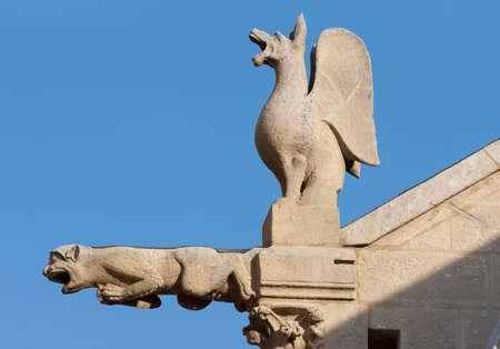 gargoyle: Gargoyle and cimera in the cathedral of Burgos, Spain Stock Photo