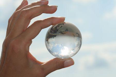 maintain: glass globe in hand Stock Photo