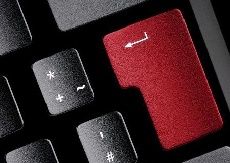 edv: Nero tastiera con un tasto rosso. Di utilizzarlo a fini di concetti tecnici.  Archivio Fotografico