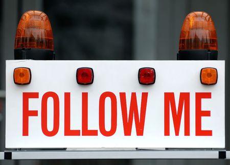 follow: Follow me sign Stock Photo