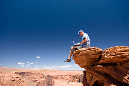 activ: USA. Arizona. Page. Horseshoe Bend. Man with notebook