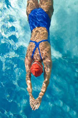 Athletic swimmer is diving in a swimming pool Stock Photo - 1904641