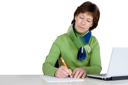 activ: Senior woman with a notebook is writing. Full isolated studio picture Stock Photo