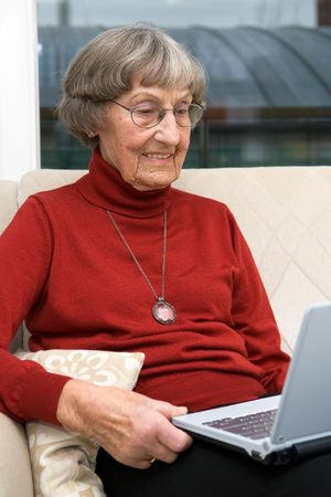 activ: Activ senior woman (80s) with a modern and small notebook