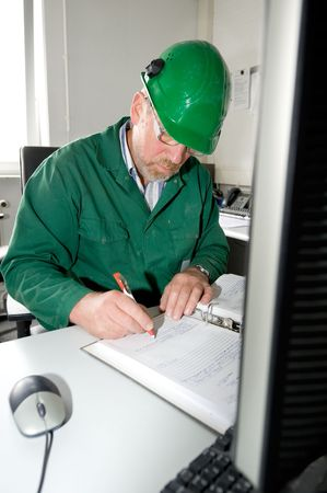 Industrial worker in his office is making a notice Stock Photo - 3728862