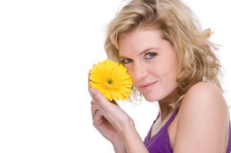 Full isolated portrait of a beautiful  caucasian woman with a gerbera (daisy) photo