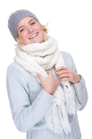 Full isolated portrait of a beautiful  caucasian smiling woman with muffler and cap photo