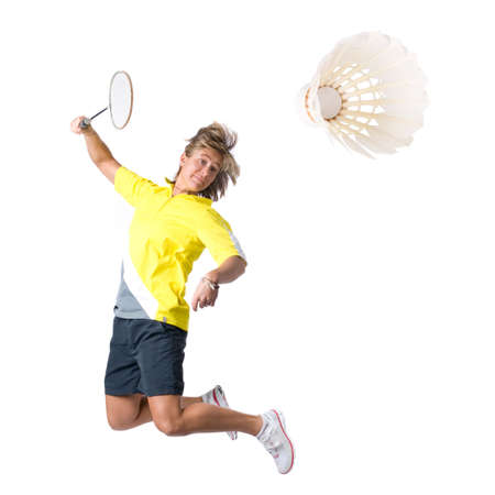 badminton racket: Full isolated picture of a  caucasian woman playing badminton