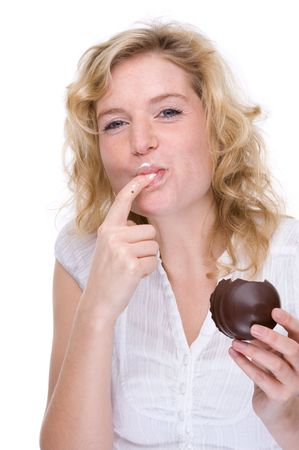 Full isolated portrait of a beautiful  caucasian woman eating some sweets photo