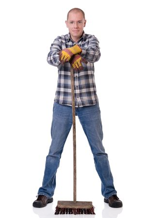 lumberman: Full isolated studio picture from a young  worker with a broom