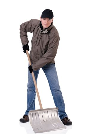 Full isolated studio picture from a young  man with a snow shovel Stock Photo