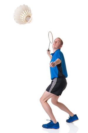 Full isolated picture of a caucasian man playing badminton