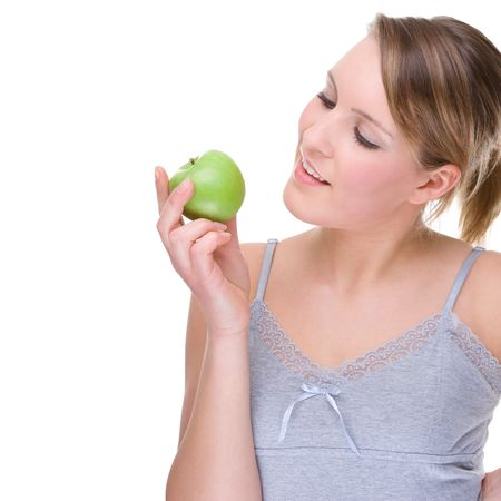 Full isolated portrait of a beautiful caucasian woman with apple photo