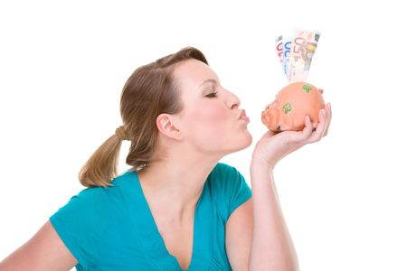 Full isolated portrait of a beautiful caucasian woman with a piggybank photo