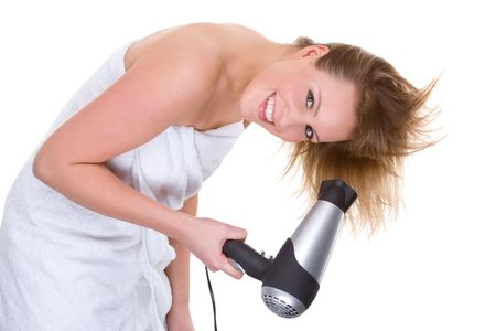 Full isolated portrait of a beautiful caucasian woman with a hairdryer photo