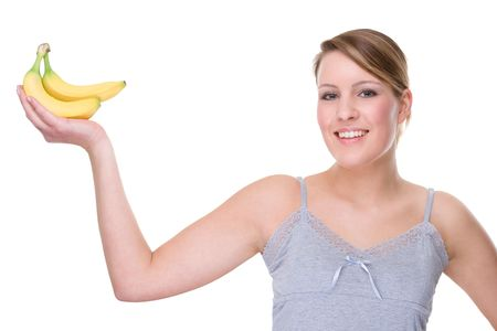 Full isolated portrait of a beautiful caucasian woman with some bananas photo