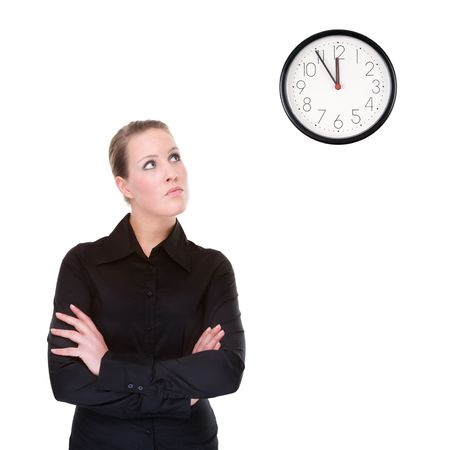 Full isolated portrait of a beautiful caucasian businesswoman locking at the clock photo