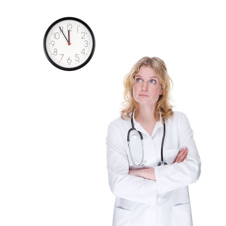 Full isolated portrait of a beautiful caucasian doctor looking at the clock photo
