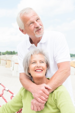 Smiling senior couple at the beach photo
