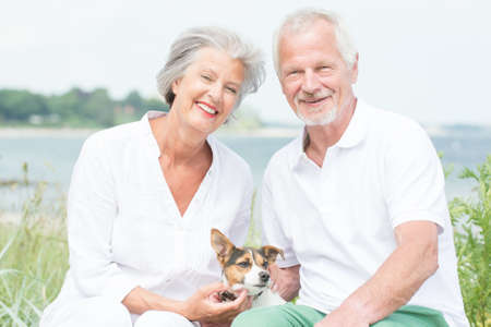 senior adult: Smiling and actice senior couple with dog
