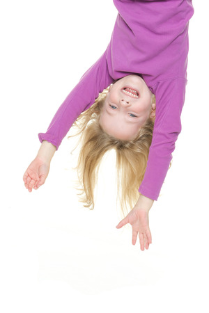 Smiling young girl hanging in front of white background photo