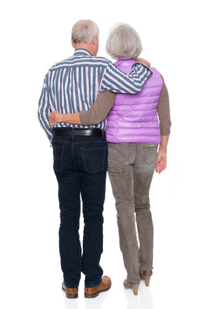 bum: Smiling senior couple in front of white background
