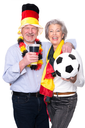 Senior sport fans (germany) in front of white backround photo