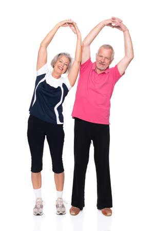 Active senior couple in front of white background photo