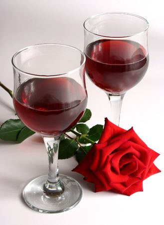two glasses of red wine with a red rose Stock Photo
