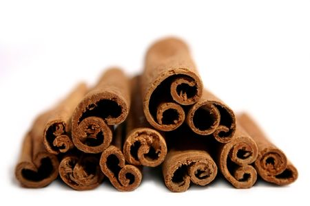 savour: cinnamon stick isolated on white background