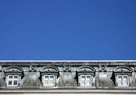 dormer: old grey dormer window with blue sky