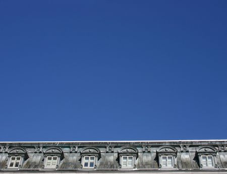 old grey dormer window with blue sky Stock Photo - 795455