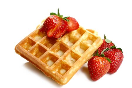 waffles and strawberries isolated on white background