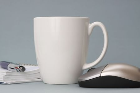 white work: cup of coffee with agenda and computer mouse