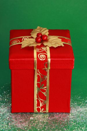 christmas gift: red christmas gift box, green background