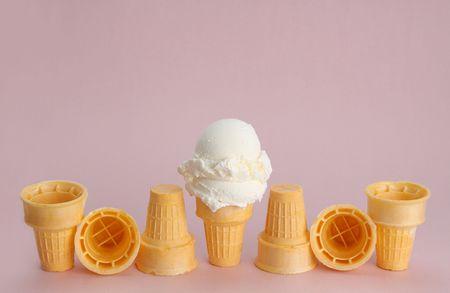 vanilla ice cream cone, pink background Stock Photo - 4055990
